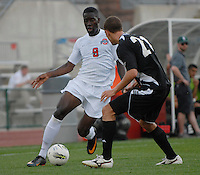 Ohio State midfielder Chris Hegngi (9) attacks on Binghamton defender Tommy Klim (22) as OSU takes on Binghamton in the first half of an NCAA men's college soccer game in Columbus, Ohio on Sunday, Sept. 11, 2011, at Jesse Owens Memorial Stadium.