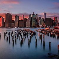 Photo prints, framed, matted and/or print only are available at <br /> <br /> http://juergen-roth.pixels.com/featured/welcome-to-nyc-juergen-roth.html<br /> <br /> This New York City skyline photography image of the Big Apple skyline shows the Freedom Tower and surrounding FIDI skyscrapers. The image was photographed on a beautiful winter evening minutes before sunset. The New York City World Trade Center is a complex of buildings in Lower Manhattan. The skyscraper is replacing an earlier complex of 7 buildings with the same name on the same site. The original World Trade Center featured landmark twin tower, were destroyed in a terrorist attack on 11 September 2001. The new site is now a rebuilt with six new skyscrapers with a 911 memorial to those killed in the terrorist attacks. One World Trade Center is the tallest skyscraper in the United States.<br /> <br /> Good light and happy photo making!<br /> <br /> My best,<br /> <br /> Juergen<br /> www.RothGalleries.com<br /> @NatureFineArt<br /> https://www.facebook.com/naturefineart