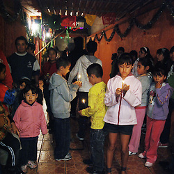 """Mexico, Federal District, Mexico City, Azcapotzalco, December 16, 2011. """"Posada"""" means """"inn"""" in Spanish, and on each of the nine days before Christmas, groups of devout Catholic parishioners like these will reenact Mary and Joseph's search for shelter during their Biblical journey from Nazareth to Bethlehem. Multimedia and more at www.mexicoculturalcalendar.com"""