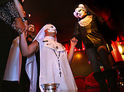 The Sisters of Perpetual Indulgence gather at CC Slaughters for another night of passing out condoms and taking sexual safety within the gay community. Dressed as nuns, several sisters came in from Seattle to conduct a black veil ceremony before heading out on their mission..