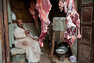 Eyptian meat vendor in ancient bazaar, Luxor, Egypt