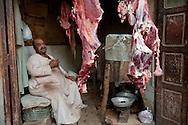 Eyptian meat vendor in ancient bazaar, Luxor, Egypt