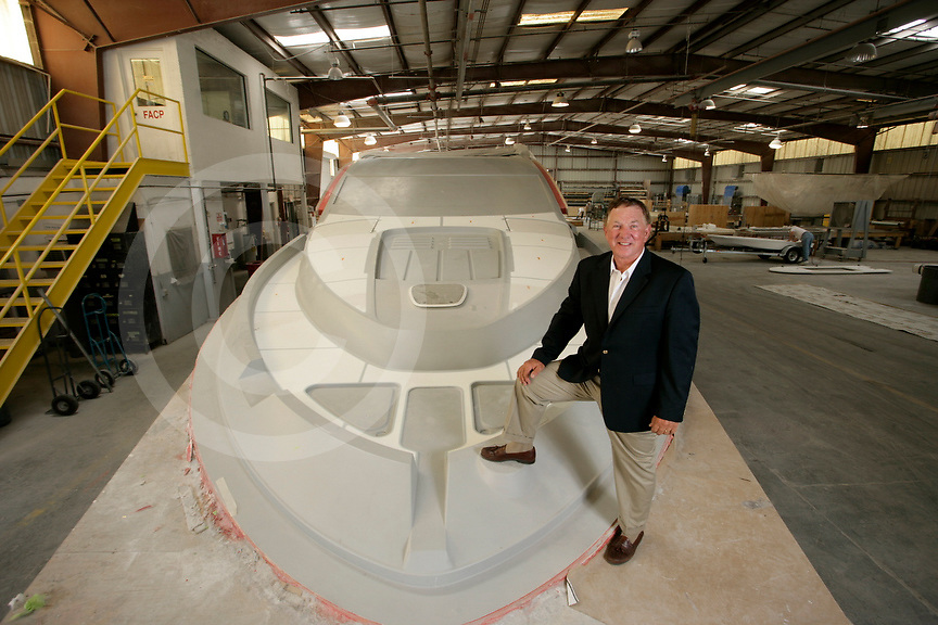 Portrait of Bob Long, CEO of Marine Concepts, with a &quot;deck plug&quot; used in making molds for boats.<br /> Photo by Brian Tietz<br /> www.briantietz.com 2008