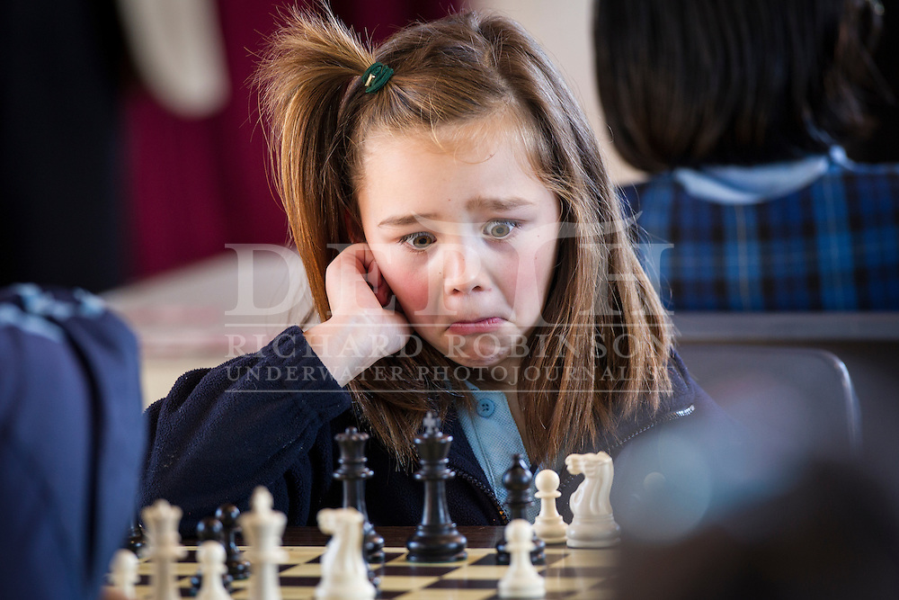 Checkmate, six-year-old Chantelle Vossen-Chong in action during the 13th annual Auckland Girls Chess Championships. 12 June 2013 New Zealand Herald Photograph by Richard Robinson.
