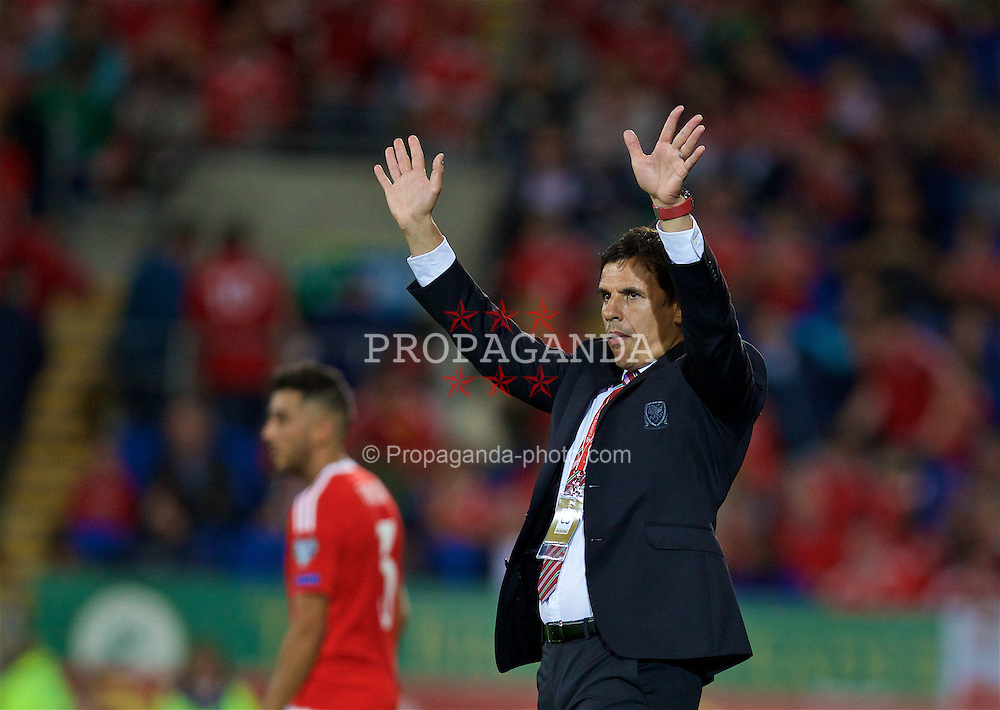 CARDIFF, WALES - Monday, September 5, 2016: Wales' manager Chris Coleman responds to the supporters with a wave during the 2018 FIFA World Cup Qualifying Group D match against Moldova at the Cardiff City Stadium. (Pic by David Rawcliffe/Propaganda)