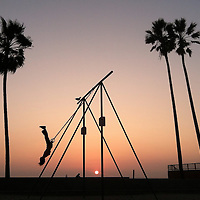 A man exercises on theVenice Beach Rings at sunset, February 6, 2013