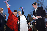 JoAnne Still (left) and her partner Mary Mendola (center), both of Accord, NY rejoicing together after their wedding ceremony performed by Mayor Jason West (right) in New Paltz, NY on Friday, February 27, 2004.  ©  Chet Gordon for the New York Daily News.