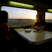 The Ghan.  Passengers waking up early to watch the sunrise from the Diner in the red service, over the desert approximately 200kms south of Tennant Creek and 300kms north of Alice Springs. Image © Arsineh Houspian/Falcon Photo Agency.