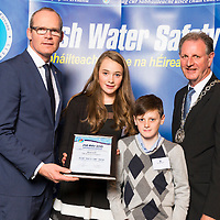 Dublin - Ireland, Tuesday 8th November 2016:<br /> Simon Coveney TD, Minister for Housing, Planning &amp; Local Government with 'Seiko Just In Time Award' recipient Emily Duggan (Laois) with her brother Sean and Martin O'Sullivan, Chairman of Irish Water Safety at the annual Irish Water Safety Awards held at Dublin Castle.  Photograph: David Branigan/Oceansport