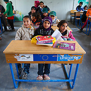 Hayam (center-left) and her classmates are about to start class. Zaatari camp for Syrian refugees, Jordan, March 2014.