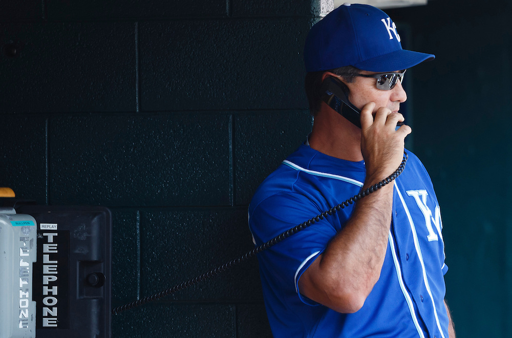 Aug 6, 2015; Detroit, MI, USA; Kansas City Royals bench coach Don Wakamatsu (22) on the phone during the game against the Detroit Tigers at Comerica Park. Mandatory Credit: Rick Osentoski-USA TODAY Sports