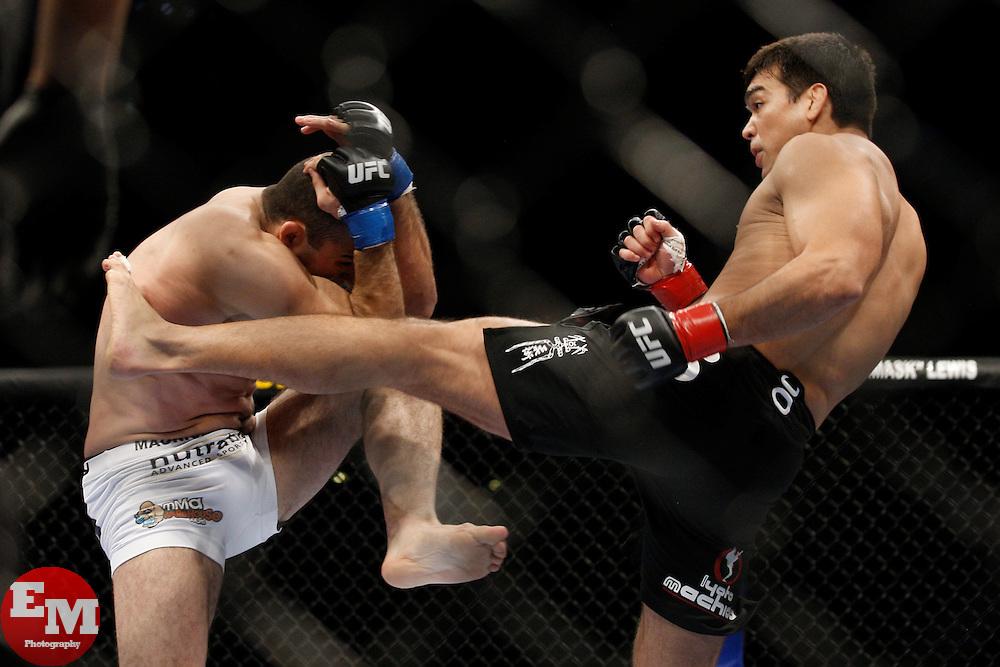 October 24, 2009; Los Angeles, CA; USA; Lyoto Machida (black trunks) throws a kick at Mauricio Rua(white trunks) during their UFC light heavyweight championship bout at UFC 104.   Machida won via controversial unanimous decison .  Mandatory Credit:  Ed Mulholland