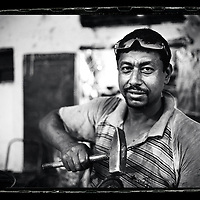 Cairo, Egypt  June 2008<br /> Ayman, 38 years old, tinsmith.<br /> Photo: Ezequiel Scagnetti