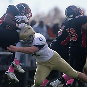 Salesianum defensive end Kyle Cathers (92) makes a tackle in the second quarter during a regular season football game between No. 2 Salesianum and No.1 William Penn Saturday, Oct. 31, 2015 at William Penn High School in New Castle.