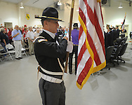 Wes Hatcher posts the colors during a Memorial Day service at the National Guard Armory in Oxford, Miss. on Monday, May 31, 2010.
