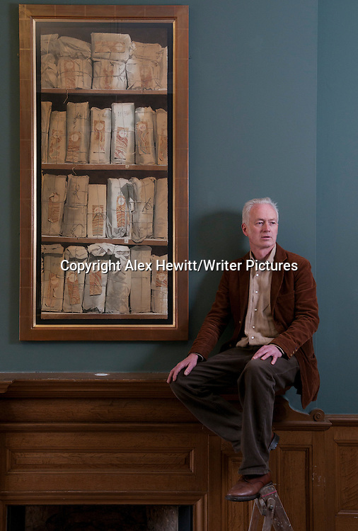 Hugh Buchanan, Scottish Painter with a painting from his exhibition. Summerhall, Edinburgh 28th May 2013..picture by Alex Hewitt