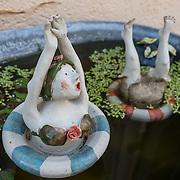 Funny clay figurines dive in pond. Stein am Rhein, Switzerland, Europe.