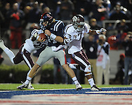 Ole Miss quarterback Bo Wallace (14) scores on a 14 yard run as Texas A&M defensive back Deshazor Everett (29) and Texas A&M defensive back Tramain Jacobs (7) chase in Oxford, Miss. on Saturday, October 6, 2012. Texas A&M won 30-27...