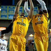 George Mason Forward Paris Bennett (1) and George Mason Forward Jonathan Arledge (5) battle for the loose ball in the second half of a regular season NCAA basketball game against Delaware Saturday, March 2, 2013 at the Bob Carpenter Center in Newark Delaware.