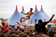 READING, ENGLAND - AUGUST 24: A music fan soaks up the atmosphere as You Me At Six performs live on the Main Stage during Day One of Reading Festival 2012 at Richfield Avenue on August 24, 2012 in Reading, England.  (Photo by Simone Joyner/Getty Images)