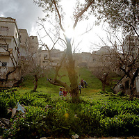 A family has a picnic on a green area in Amman, Jordan. February 2010.