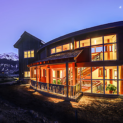 128 Silver Sage Drive, Crested Butte, Colorado.  Located in the Silver Sage subdivision, near the town of Crested Butte, this home stands out with a unique curved central core. The structural system of post and beam glulams is exposed and allows the home to flow clearly around the core, giving uninterrupted views of the entire valley. Strong curvilinear forms inside the house are repeated in the landscape, reinforcing the indoor to outdoor connection. This super-insulated home uses a ground source heat pump and solar thermal panels to heat and provide hot water to the home.