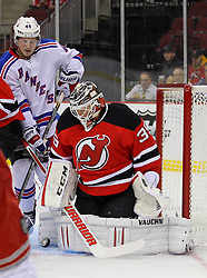 Sep 16, 2013; Newark, NJ, USA; New Jersey Devils goalie Cory Schneider (35) makes a save during the first period of their game against the New York Rangers at Prudential Center.