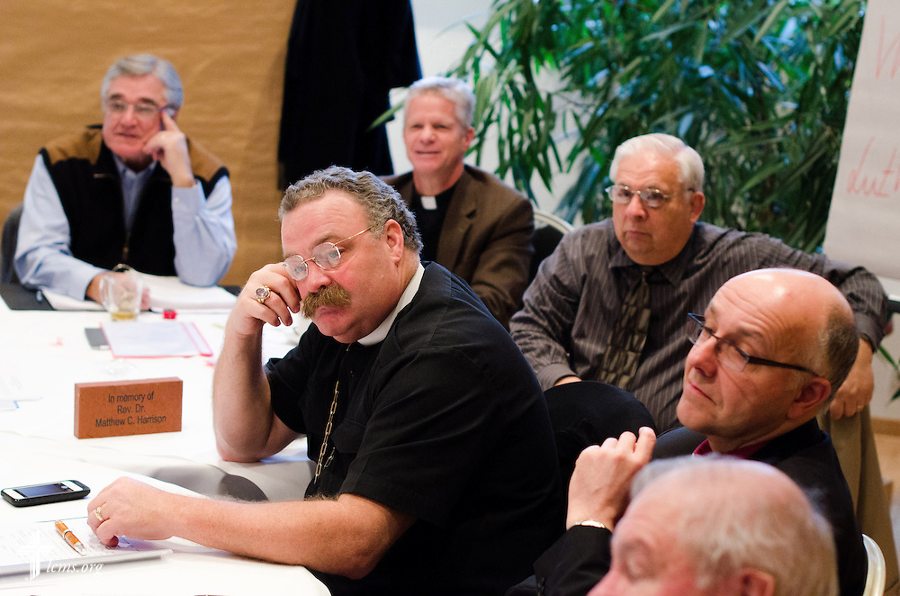 LCMS President Rev. Dr . Matthew C. Harrison (center), SELK Bishop Hans-Jörg Voigt (right), and others, listen to findings from an archeologist on Wednesday, Jan. 29, 2014, at the Luther Hotel n Wittenberg, Germany. LCMS Communications/Erik M. Lunsford