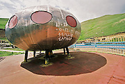 An extravagant booth of a small roadhouse near the Spitak mountain pass (northern Armenia) looks like an ufo.