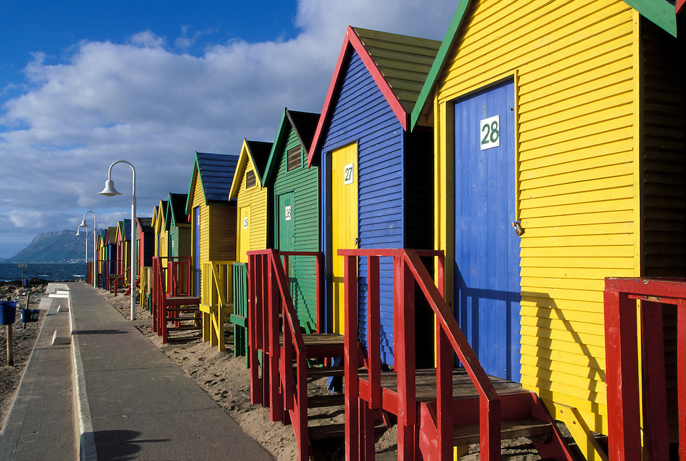 South Africa, Cape Town, Brightly painted bath houses along beach in Simon's Town