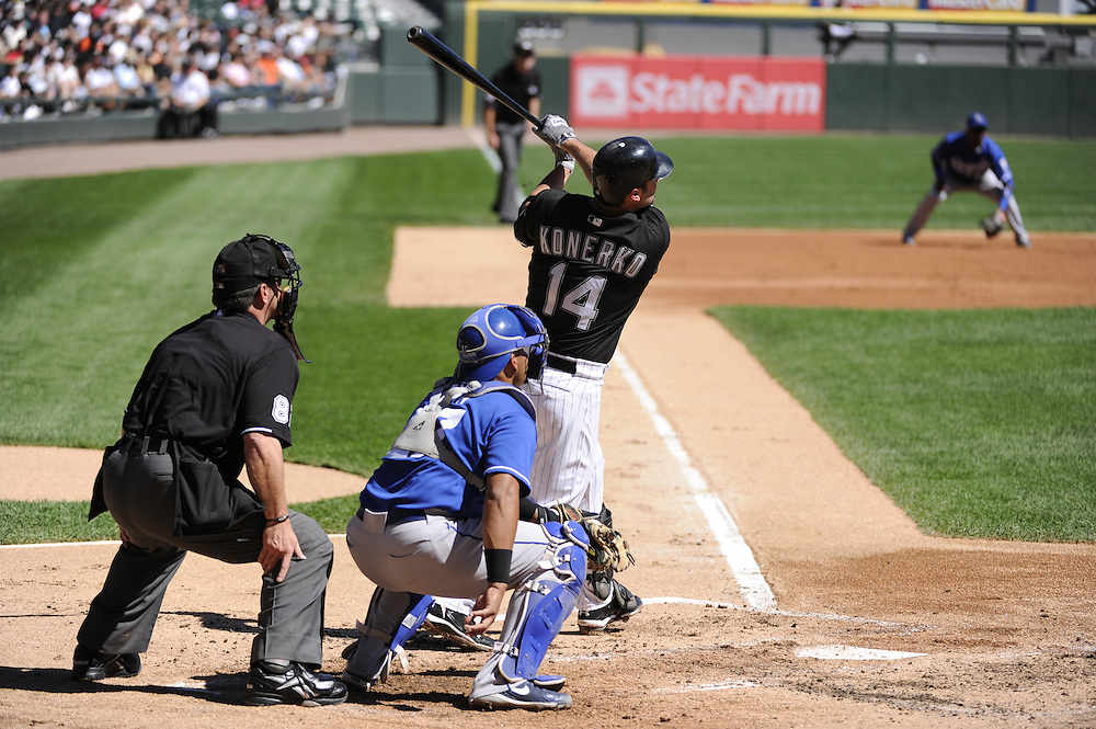 CHICAGO - SEPTEMBER 12:  Paul Konerko #14 of the Chicago White Sox hits the first of two, two-run home runs in the first inning against the Kansas City Royals on September 12, 2010 at U.S. Cellular Field in Chicago, Illinois.  The White Sox defeated the Royals 12-6.  (Photo by Ron Vesely)