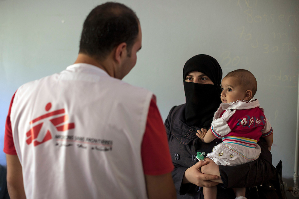 28/06/2013 Baalbek, Lebanon: An MSF (Doctors Without Borders) clinician speaks with a Syrian refugee mother about her son's health. MSF is filling a gap to provide free medical care for refugees who have been displaced to Lebanon. Estimates have placed the number of Syrian refugees in Lebanon at well over 500,000 people.