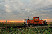 This old beauty is parked on the tracks near the plant I work at and it seems to draw me in all the time.  This morning I arrived in time to see the sun poking up under the cloudbank behind and it created the most amazing cloud patterns, so of course I had to shoot it again!<br /> <br /> &copy;2007, Sean Phillips<br /> http://www.Sean-Phillips.com