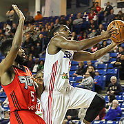 Delaware 87ers Guard JUWAN STATEN (7) drives towards the basket as Raptors 905 Guard SCOTT SUGGS (5) defends in the first half of a NBA D-league regular season basketball game between the Delaware 87ers and the Raptors 905 Friday, Jan. 15, 2016. at The Bob Carpenter Sports Convocation Center in Newark, DEL.