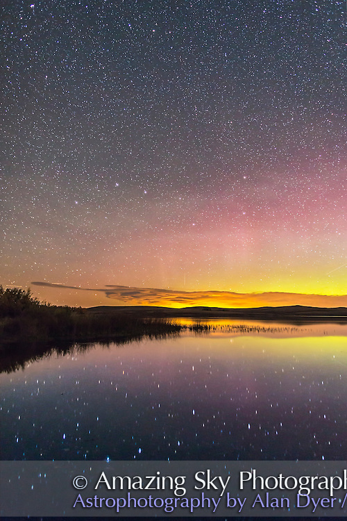 The Big Dipper reflected in the still waters of the lake at Police Outpost Provincial Park, in southern Alberta, on September 26, 2016, with an aurora to the north at right. Only in autumn can one shoot the Dipper reflected in the water in the evening sky, as it is then riding low along the northern horizon. This is from a latitude of 49&deg; N where the Dipper is circumpolar. It is also called the Plough in Great Britain.<br /> <br /> This is a stack of 4 x 25 second exposures for the dark ground to smooth noise and one 25-second exposure for the sky and water, all with the 25mm Canon lens at f/2.2 and Canon 6D at ISO 3200. Taken with dark frame LENR on.