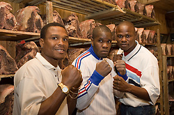 July 6, 2006 - New York, NY - Former Welterweight champions Ike Quartey (l) and Vernon Forrest (r) pose around unbeaten junior middleweight contender Sechew Powell in the meat locker of Gallagher's Steakhouse before announcing their upcoming August 5, 2006 fights at the Theater at Madison Square Garden.  Sechew Powell will face Kassim Ouma on the undercard of the Quartey-Forrest fight.