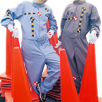 """Portrait of two crash dummies with orange safety cones, """"Vince"""" & """"Larry"""""""