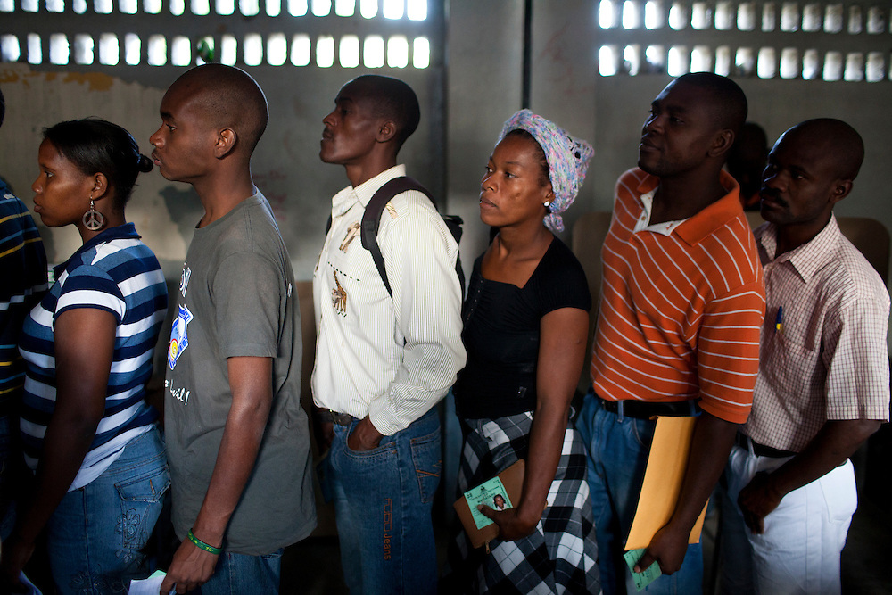 Voters wait in line to cast their ballots in presidential and legislative elections on November 28, 2010 in Port-au-Prince, Haiti.