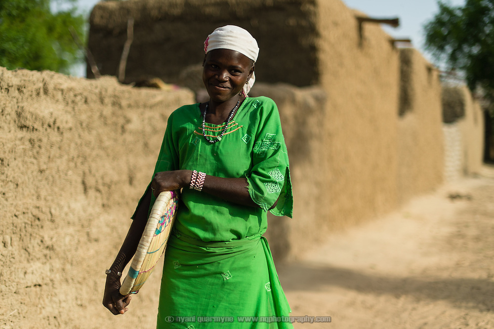 Ramma Ado in the village of Kanwa-Maraki where she lives in the Zinder Region of Niger, on 25 July 2013. She is holding a maraki - a kind of traditional sifter from which the village derives its name.