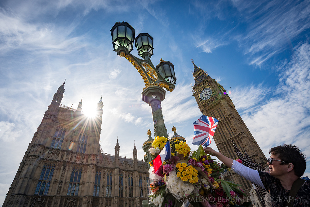 People attending the March for Europe stop by on Westminster Bridge to leave flowers in the memory of the victim of the recent terrorist attack
