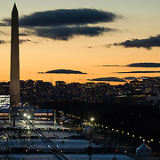WASHINGTON, USA - January 18: The sun sets over the National Mall where preparations near completion just days before the 58th Inauguration Ceremony where President-elect Donald Trump will be sworn into office in Washington, USA on January 18, 2017.