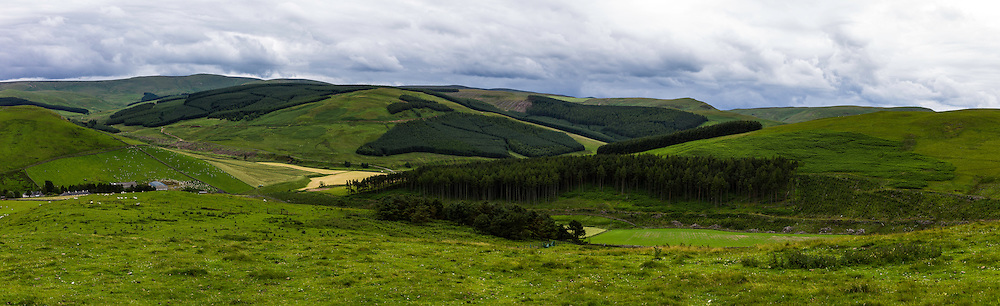 Sourhope, Yetholm, Scottish Borders, UK. 22nd July 2015. Looking south east towards Windy Gyle and the Scottish English border in the Cheviot Hills.
