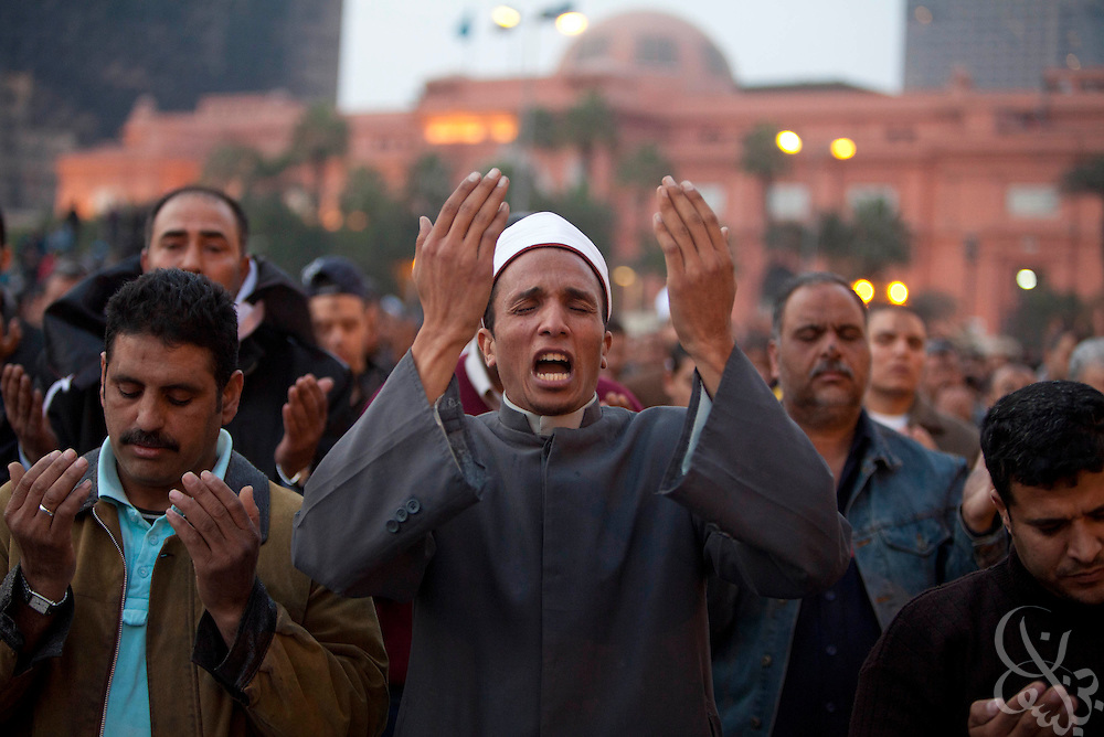 "An Egyptian Imam leads protesters in evening prayer during a ""million man march"" demonstration February 01, 2011 in Central Cairo's Tahrir, or ""Liberation"" square. The march capped a week of protests that are threatening to bring down the nearly 30 year old regime of Hosni Mubarak."