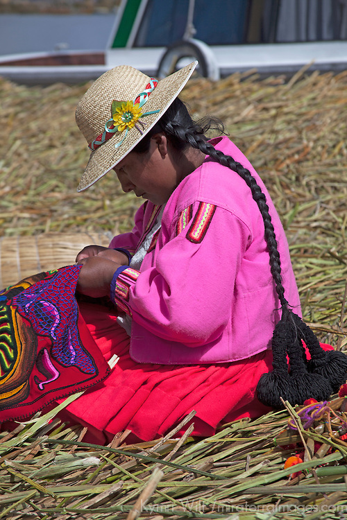 South America, Peru, Uros Islands. Uros woman doing embroidery on the floating reed islands of Lake Titicaca.