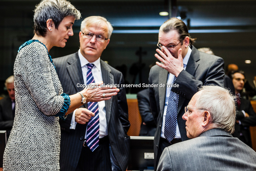 German Finance Minister Wolfgang Schaeuble, right, speaks with from left to rigth: Danish Finance minister Margrethe Vestager, EU Commissioner for Economic and  Monetary Affairs Olli Rehn and Sweden's Finance Minister Anders Borg during a meeting of EU finance ministers at the EU Council building in Brussels on Tuesday, Nov. 13, 2012. Shoring up Europe's banking sector and strengthening oversight of economic policies will likely top the agenda of a meeting Tuesday of the European Union's 27 finance ministers.