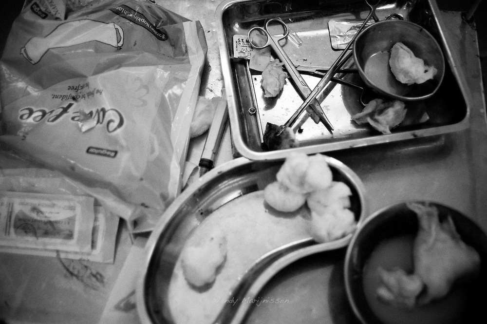 Used surgical materials and trays used by Dr. Musarat during an emergency surgery in the labour room. Karachi, Pakistan, 2010
