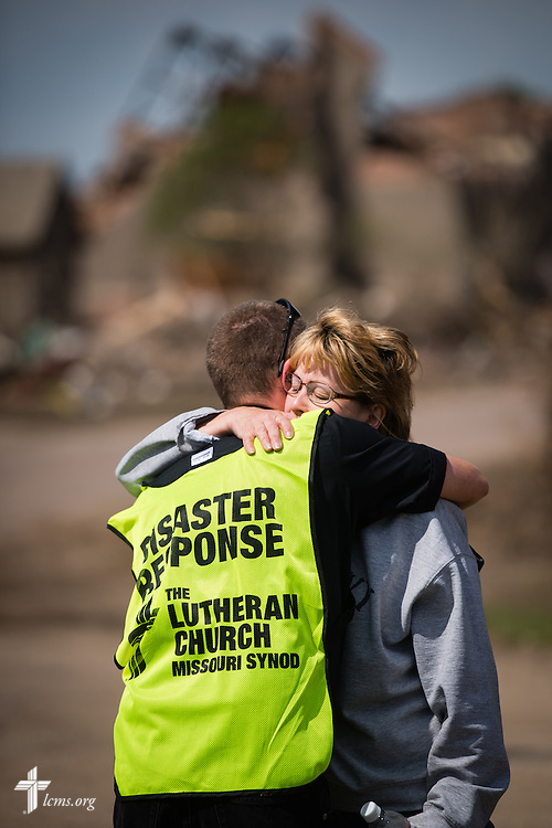 The Rev. Brian Bucklew, pastor at Zion Lutheran Church, hugs Sonia Wills on Tuesday, May 12, 2015, in Delmont, S.D. A tornado swept through the area on Sunday and destroyed the church where Bucklew is pastor along with surrounding buildings in the neighborhood. LCMS Communications/Erik M. Lunsford