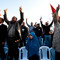 A women listens to a speech by Ennadha party leaders at a rally in Tunis.
