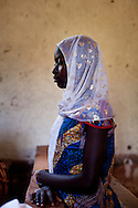 A girl prays in a church near the boder of Central African Republic. In many parts of South Sudan the church offers a third place in society to interact and play a role.