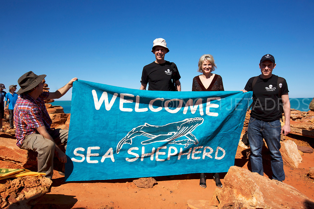 "Martin Pritchard, Director of Environs Kimberley holding a banner,""Welcome Sea Shepherd"", with former Green Leader Bob Brown and Melissa Parke, MP Federal Member for Fremantle and Jeff Hansen, Australian Director of the Sea Shepherd."